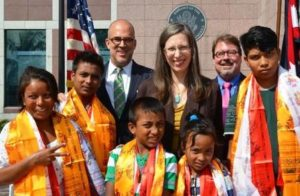 Bhutanese refugee Sahri Maya Thatal (left) and her children with the US Ambassador to Nepal, Alaina B. Teplitz, International Organization for Migration's Paul Norton, and UNHCR's Kevin Allen, in Kathmandu. Photo: US Embassy in Kathmandu