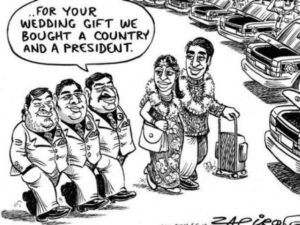 South African cartoon about Vela Gupta marriage to Aaskash Jahajgarhia in Sun City, South Africa, in 2013. The wedding prompted controversy as the government granted permission to land a large party of wedding guests at a military air force base.